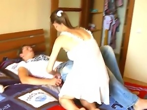 While Beatas boyfriend is sleeping, she is undressing him and sucking his weiner