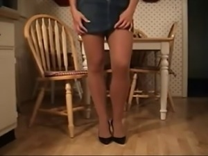 Housewife In Pantyhose Toys On The Kitchen Table