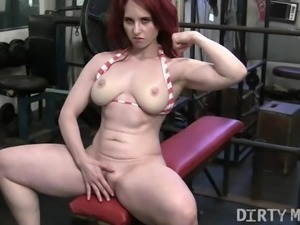 Redhead Andrea Masturbates in the Gym
