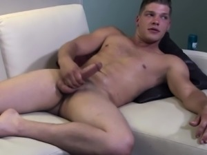 Soldier stud jerking his cock before cumshot