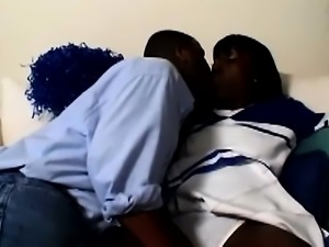 Horny black cheerleader slips out of her uniform to blow and fuck her ghetto...