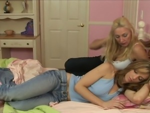 Two torrid and salacious chicks lie on the bed to enjoy a sweet lesbians action