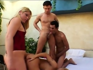 Uninhibited blonde gets spit roasted in this steaming hot foursome