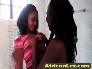 Amazing African lesbians strip and make love in bathroom
