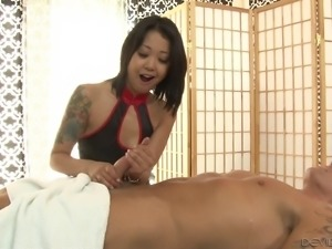 Asian chick with tattoos tries to passionately ride the white cock