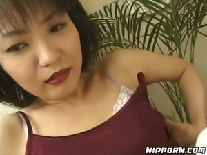 Perverted Japanese milf spreads pantyhose legs and shows off her snatch