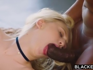 Submissive blonde fucked by two black cocks