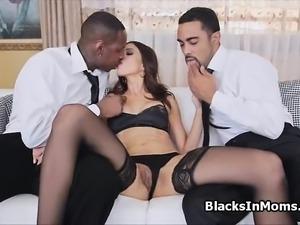 Perky milf rides two big black cocks