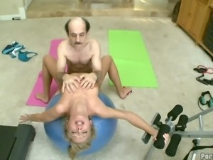 Lucky moustached guy scores a beautiful gym senorita