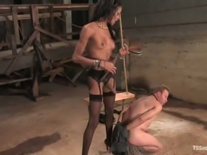 Skinny ebony shemale Mistress Soleli fucks kinky dude Zoey in a cellar