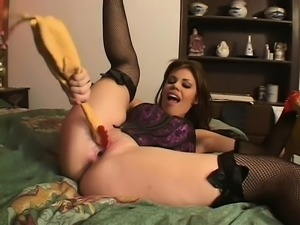 Brunette tart in stockings gets freaky with massive insertions