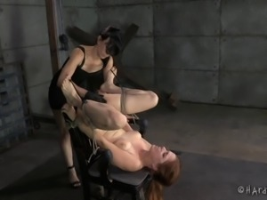 Redhead slaved lesbian with hot ass in bondage yelling while being worked on...