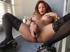 Captivating shemale Vanessa Jhons stroking her cock