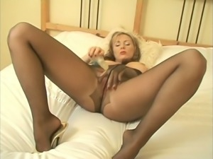 Zealous light haired playful MILF in pantyhose fucked with sex toy