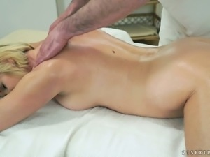 Mature slut Jennyfer is getting shagged on the massage table