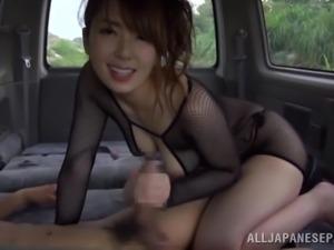 Smoking hot Japanese babe enjoys her man in the car