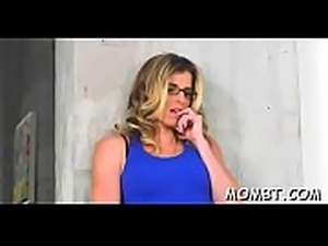 Mature chick and sexy darling are sucking studs shaft lewdly