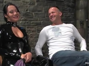 Smoking hot mistress in latex suit is torturing her lover