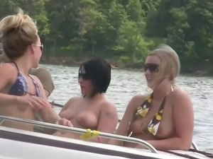 Nasty amateur girls sitting in a boat flash their boobs
