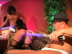 Curly brunette in black stockings participates in group sex